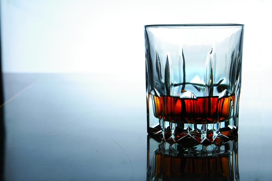 Glass Photograph - Drink In A Glass by Jun Pinzon