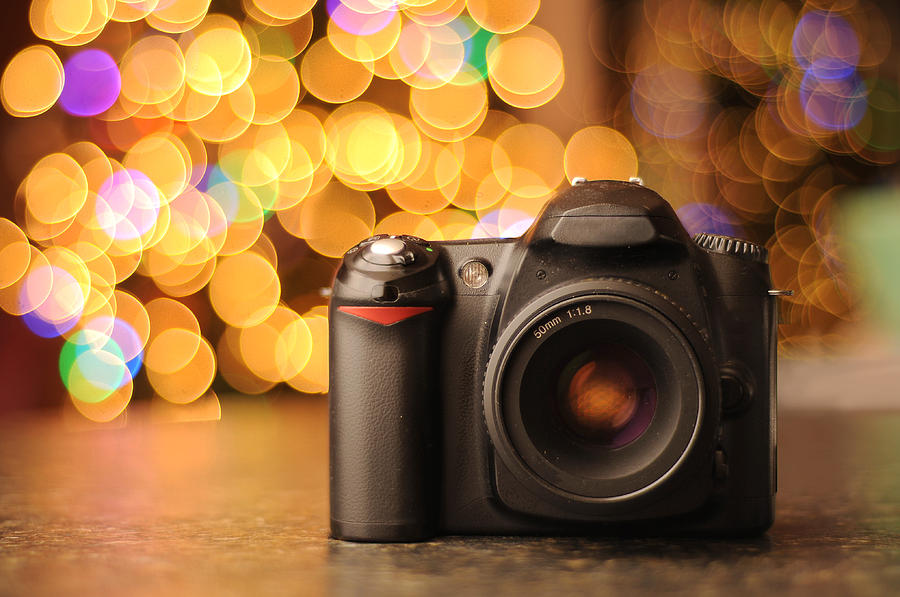 Dslr Camera With Bokeh Background Photograph By Evan Sharboneau