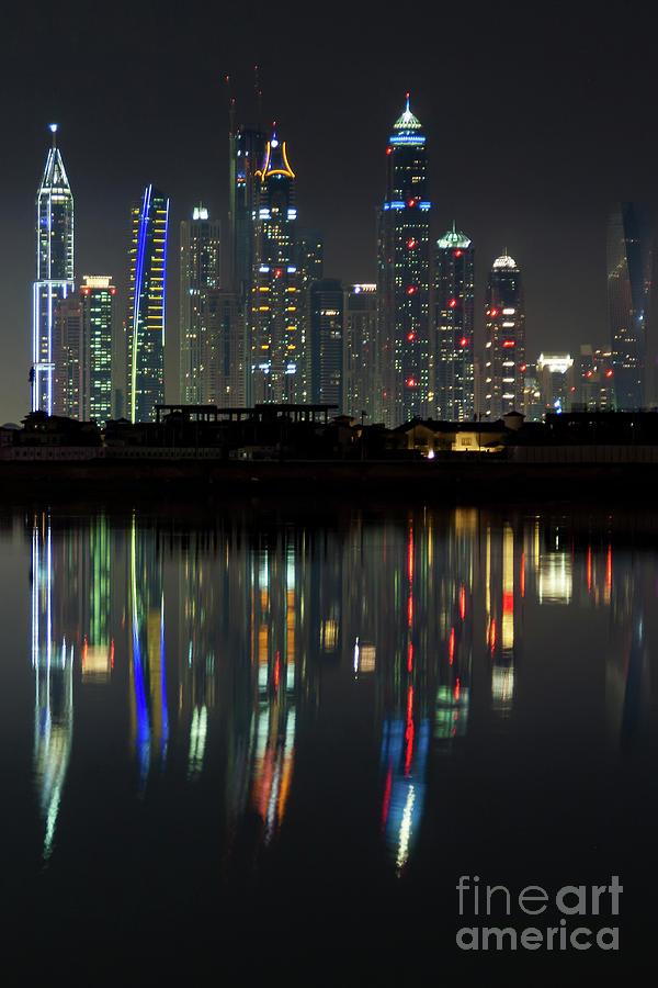 Dubai city skyline nighttime  by Andy Myatt