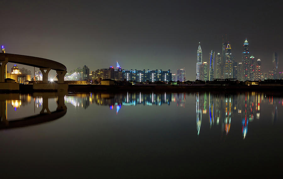 Dubai city skyline night time reflection by Andy Myatt