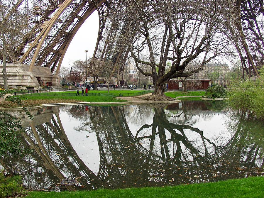 Eiffel Photograph - Eiffel Base Reflection by Mark Currier