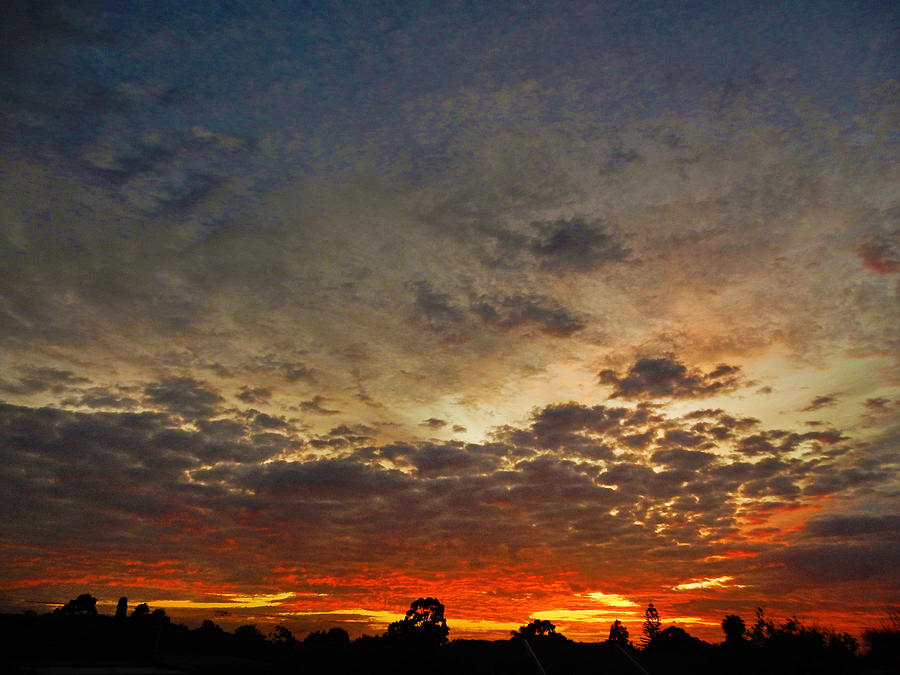 Sunset Photograph - Emerging Sunset by Mark Blauhoefer