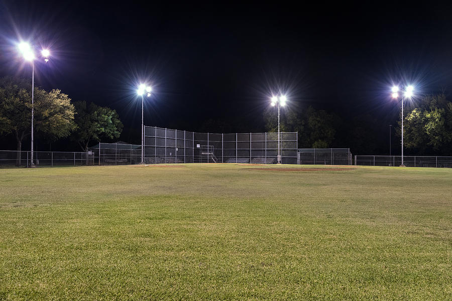 Empty Baseball Field At Night With The Lights On ...