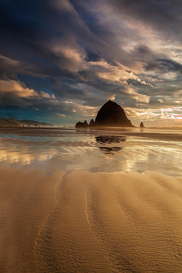 Oregon Photograph - Evening At Haystack Rock by Andrew Soundarajan
