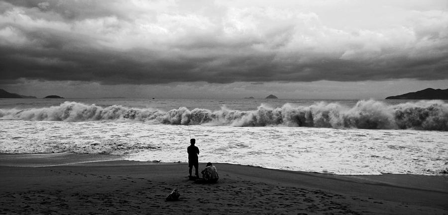 Fishing Photograph - Facing The Storm by Kim Lagerhem