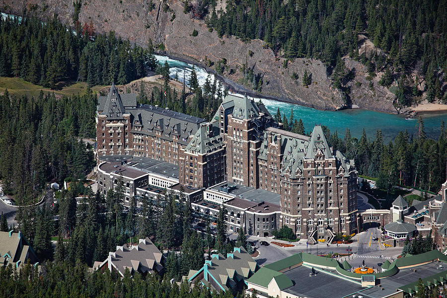 Alberta Photograph - Fairmont Banff Springs Hotel With The Bow River Falls Banff Alberta Canada by George Oze