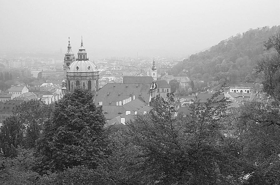 Fall Photograph - Fall Mist Surrounds St. Nicholas Church In Prague by John Julio
