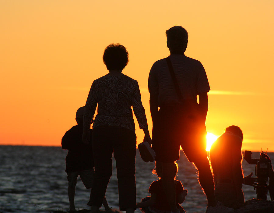 Beach Photograph - Family at Sunset on Gulf Beach by Carl Purcell