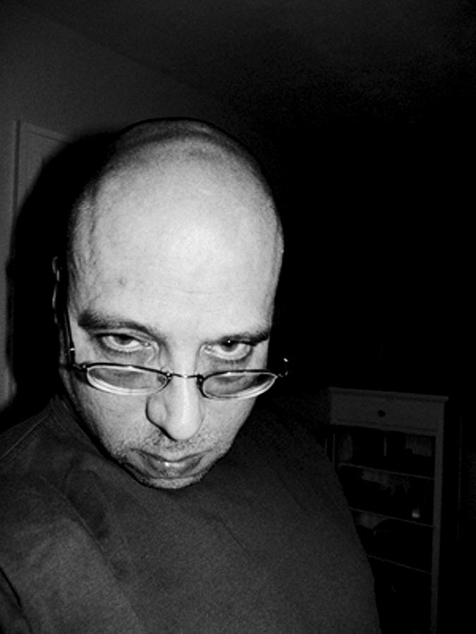 Fat Bald And Unhappy Photograph by John Toxey