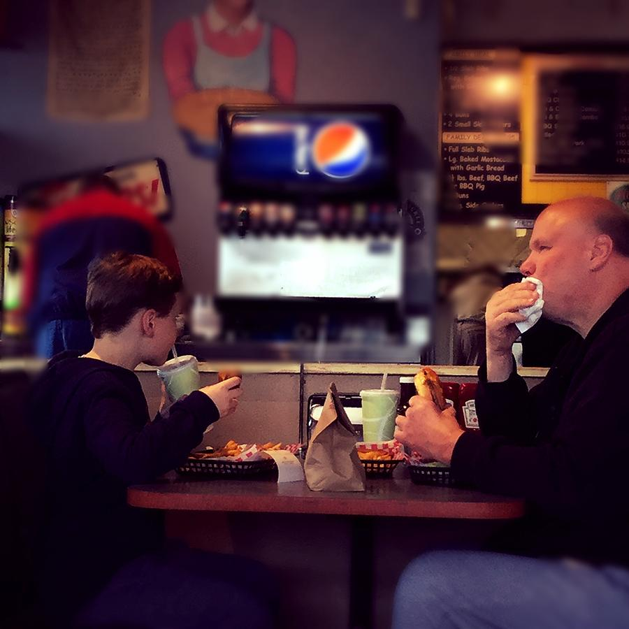 Father Photograph - Father and Son Burger Time by Frank J Casella