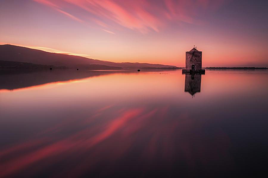 Fiery Mirror - the windmill in Orbetello reflecting itself in the mirror like water by Matteo Viviani