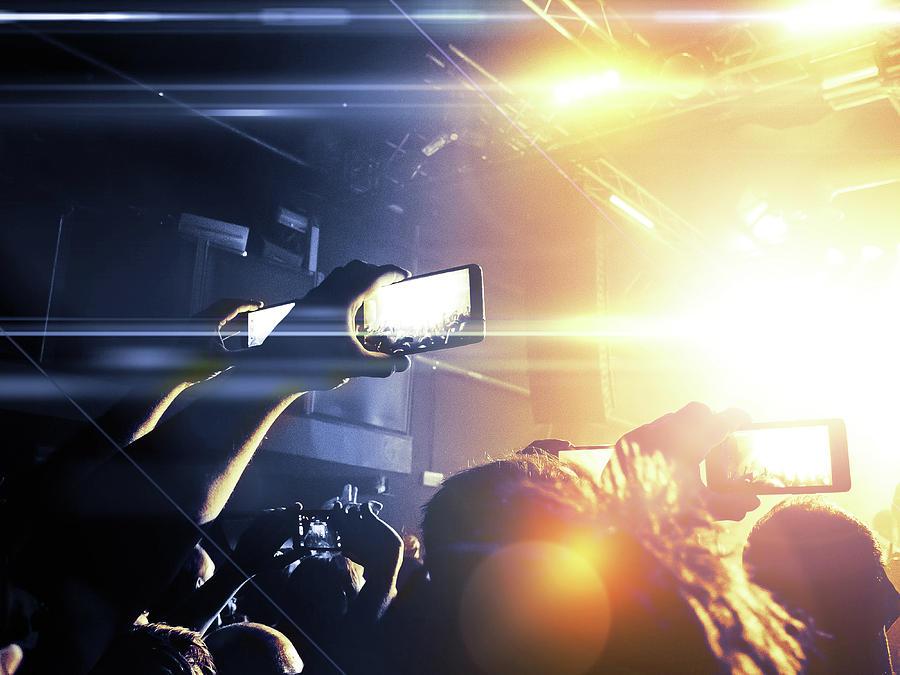 Concert Photograph - Filming A Concert by Cesare Andrea Ferrari