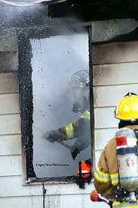 Firefighter Photograph - Firefighter In Smokey Window by Cindy Wozniak