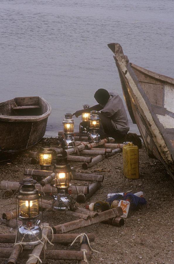 Uganda Photograph - Fisherman Prepares Lanterns For Night by Michael S. Lewis