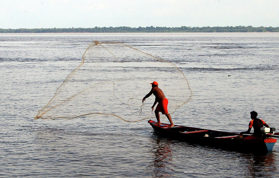 Amazon Photograph - Fisherman Throwing Net Amazon River by Day Williams