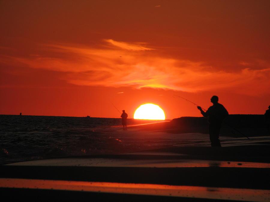 Fishing under sherbert skies by SJ Lindahl