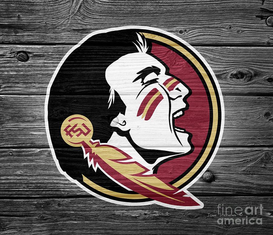 Football Photograph - Florida State University Seminoles Logo On Weathered Wood by John Stephens