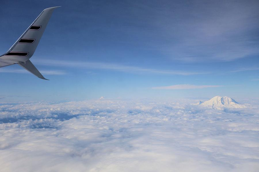 Airplane Wing Photograph - Fly Over Washington And Mount Rainier by Dan Sproul