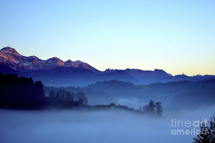 Fog Creeps Up The Valley - Switzerland Photograph