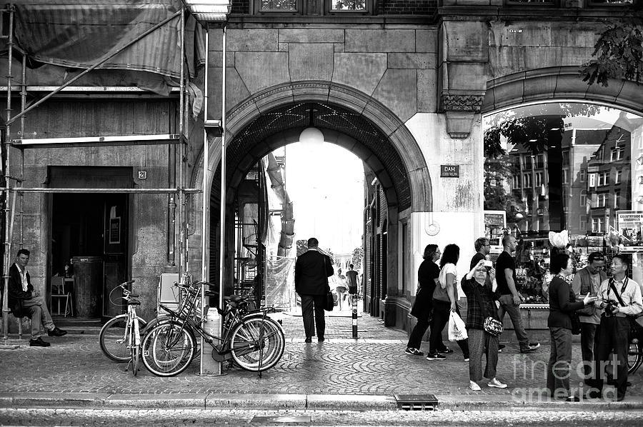 Dam Square Photograph - Follow The Light In Amsterdam Mono by John Rizzuto