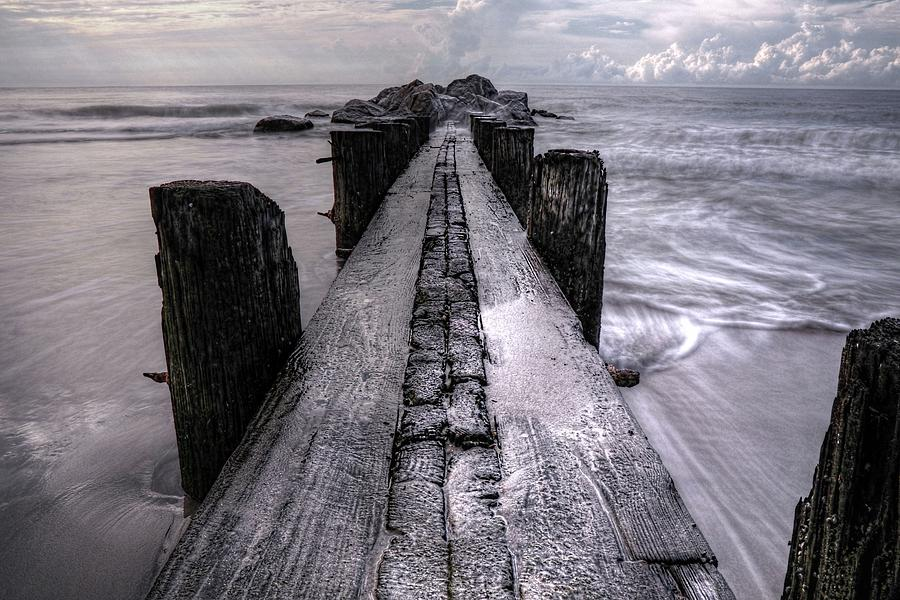 Bulkhead Photograph - Folly Beach Pilings Charleston South Carolina by Carol Montoya