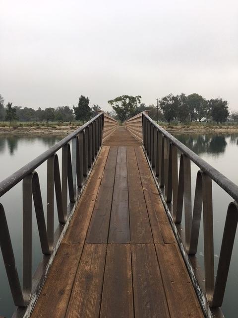 Footbridge Over Lagoon by Paula Hunter