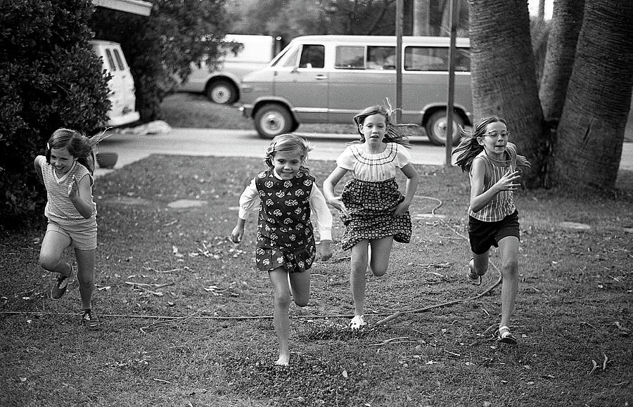 Four Girls Racing, 1972 by Jeremy Butler