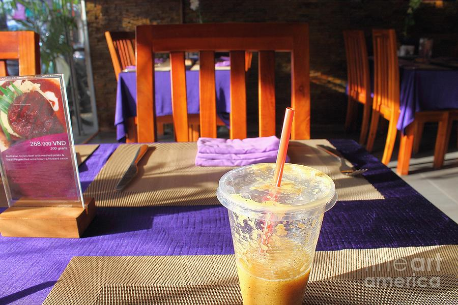 Fresh Juice Of Tropical Fruits Of Mango And Passion Fruit In The Asian Cafe. Photograph