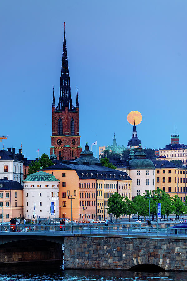 Blue Hour Photograph - Full moon over the Katarina Church and Sodermalm in Stockholm with the Riddarholmen Church in Front by Dejan Kostic