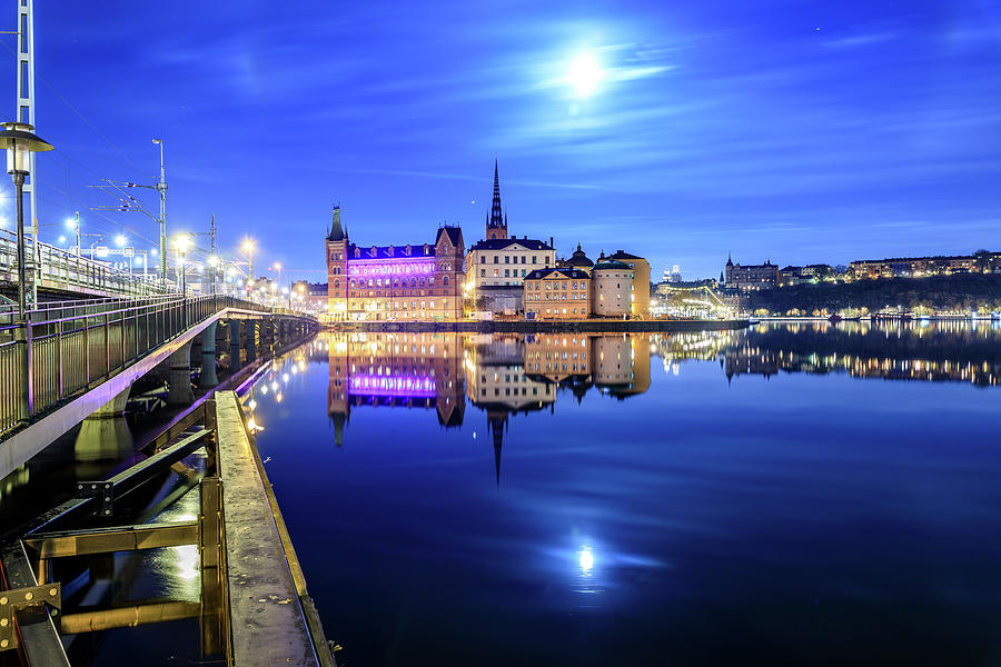 Full Moon Photograph - Full moon perfect reflection over Riddarholmen in Stockholm in the Blue Hour by Dejan Kostic
