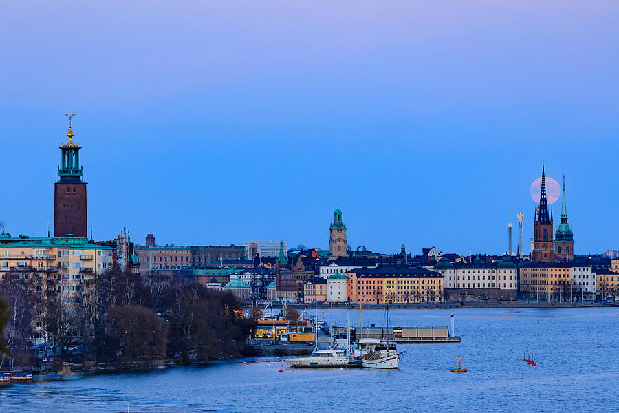 Full Moon Photograph - Full moon rising over Gamla Stan and the City Hall in Stockholm by Dejan Kostic