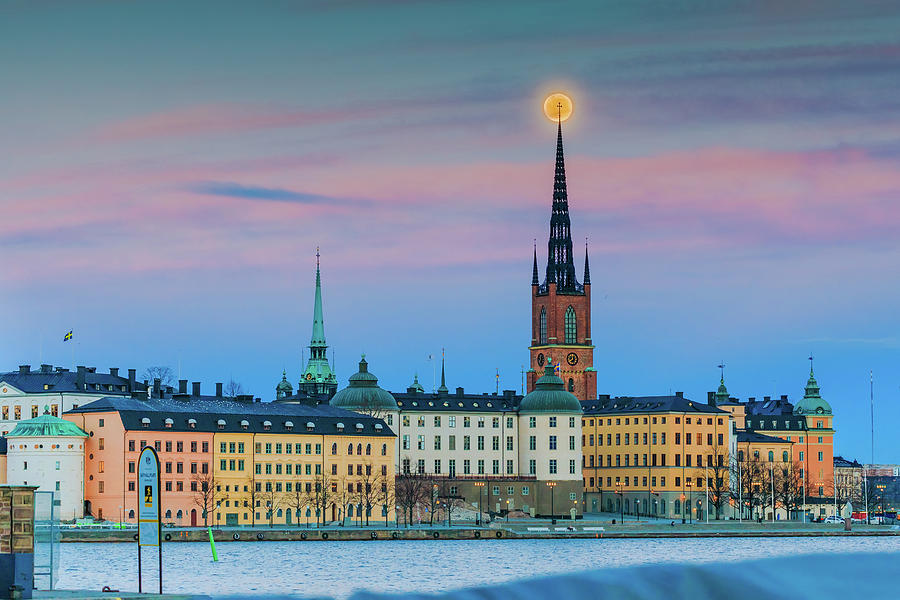 Full Moon Photograph - Full Moon rising over the Riddarholmen Church in Stockholm Old City during sunset by Dejan Kostic