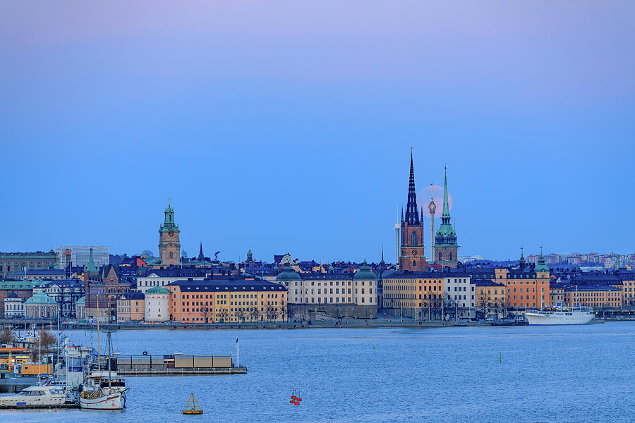 Full Moon Photograph - Full Moon Rising Over The Trio Of Gamla Stan Churches In Stockholm by Dejan Kostic