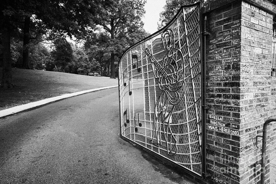 Elvis Photograph - Gate And Driveway Of Graceland Elvis Presleys Mansion Home In Memphis Tennessee Usa by Joe Fox