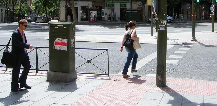 Gentleman Photograph - Gentleman And Lady On Princesa Street - Madrid by Thomas Bussmann