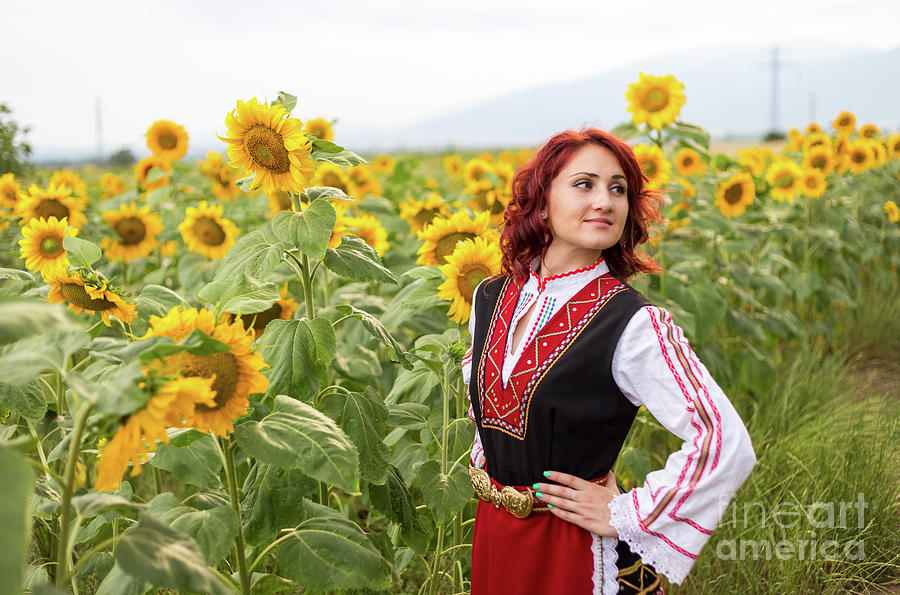 Blooming Photograph - Girl And A Sunflower by Nikolay Stoimenov