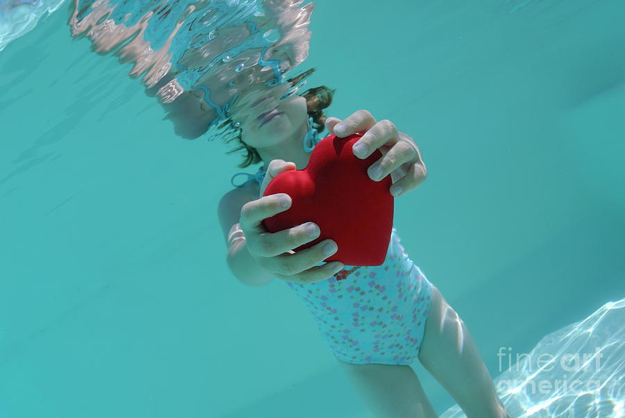 Love Photograph   Girl Holding Heart Shaped Symbol In Swimming Pool By Sami  Sarkis