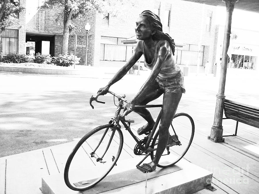 Girl on bike sculpture grand junction co photograph by tommy anderson Today s home furniture design grand junction co