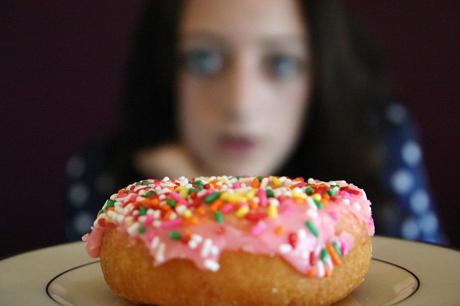 Girl With Doughnut Photograph