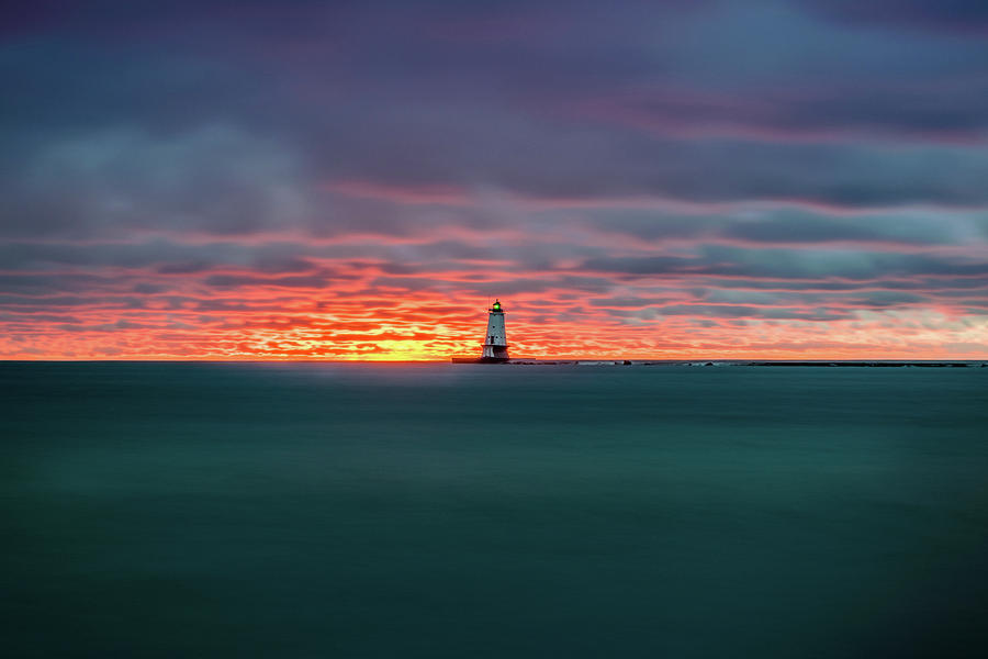 Lighthouse Photograph - Glowing Sunset on Lake With Lighthouse by Lester Plank