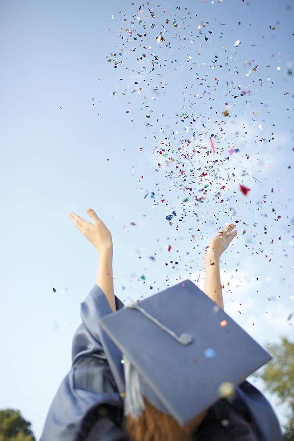 Achievement Photograph - Graduate Tossing Confetti Seen by Gillham Studios