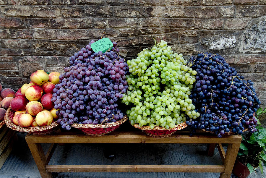 Fruit Photograph - Grapes And Nectarines On A Bench by Todd Gipstein