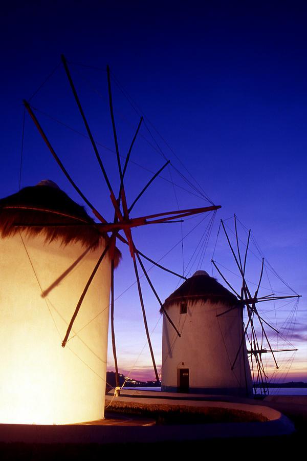 Landscape Photograph - Greece. Mykonos Town. Illuminated Windmills At Dusk. by Steve Outram