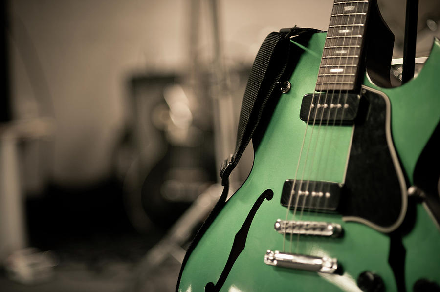 Horizontal Photograph - Green Electric Guitar With Blurry Background by Sean Molin - www.seanmolin.com