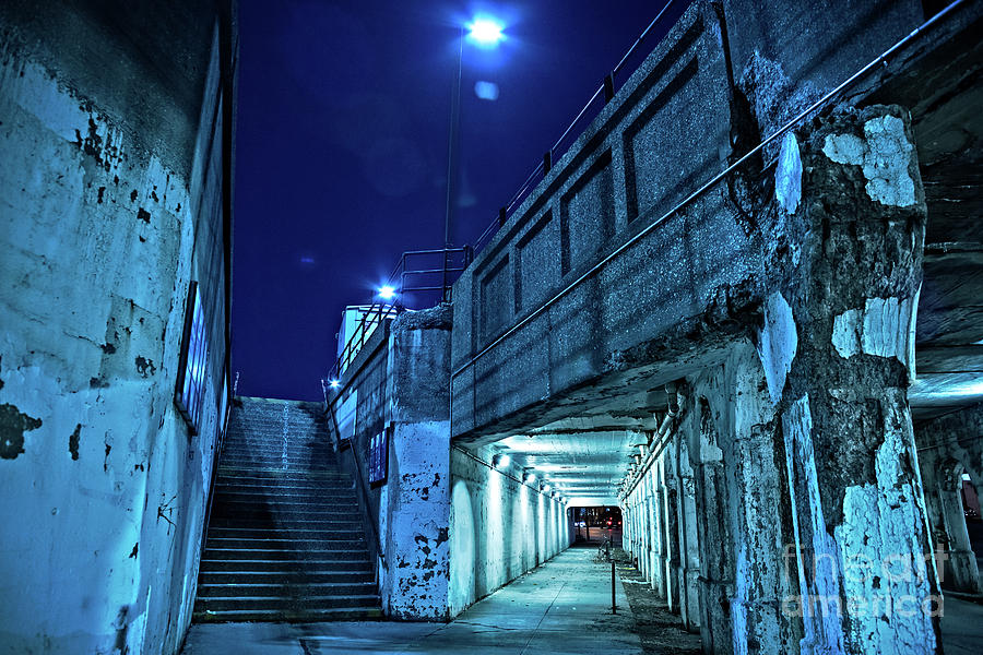 Night Photograph - Gritty dark Chicago city street under industrial bridge viaduct at night by Bruno Passigatti