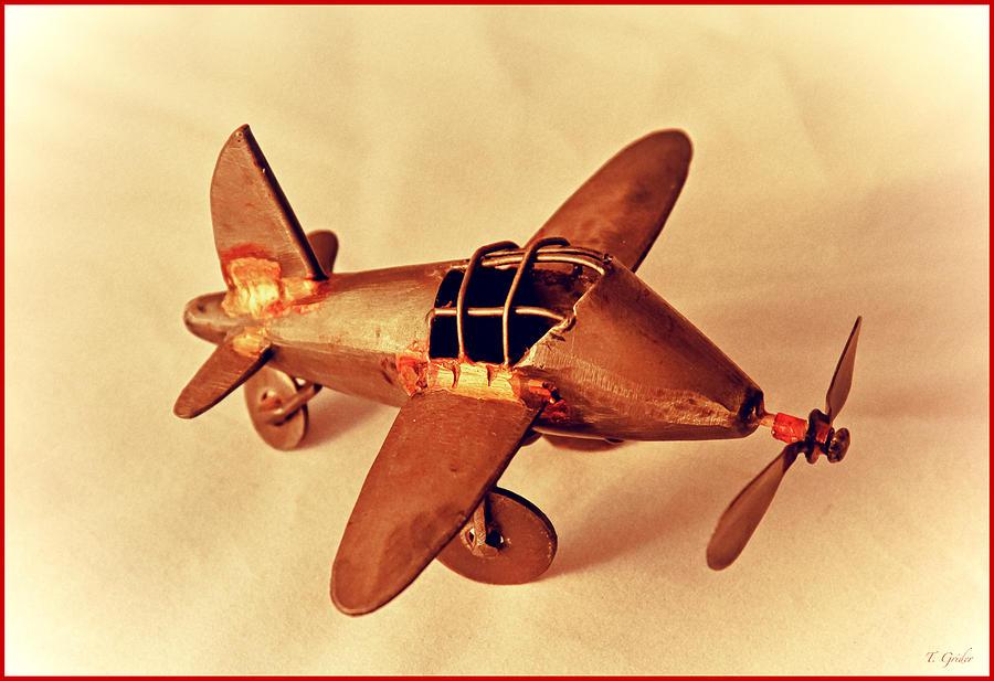 Retro Photograph - Handmade Metal Toy Plane by Tony Grider
