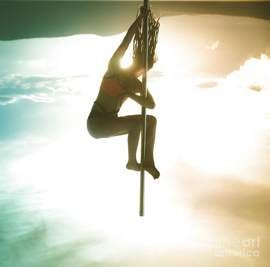 Hanging From The World Photograph