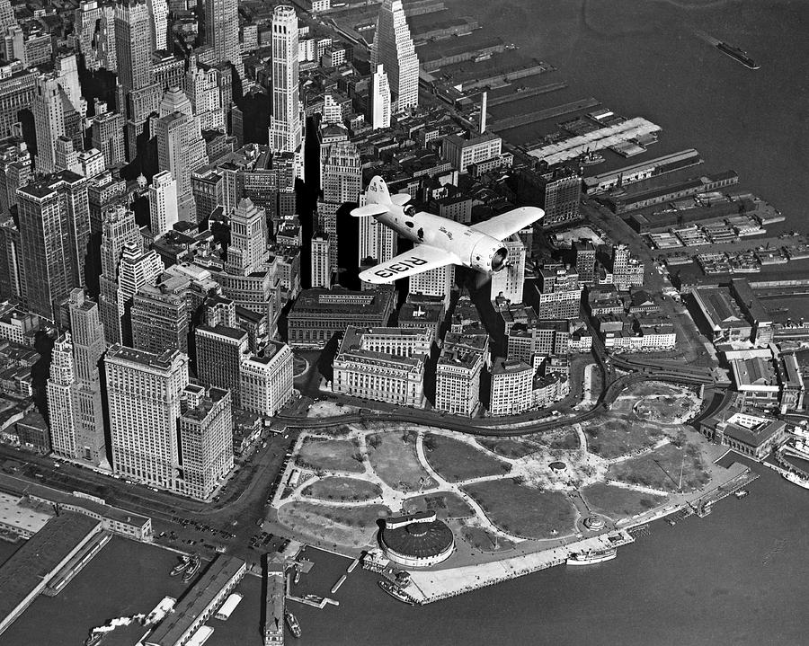 1930's Photograph - Hawks Plane Over Battery Park by Underwood Archives