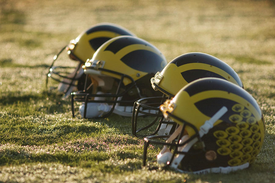 Helmets on the Field at Dawn by Michigan Helmet