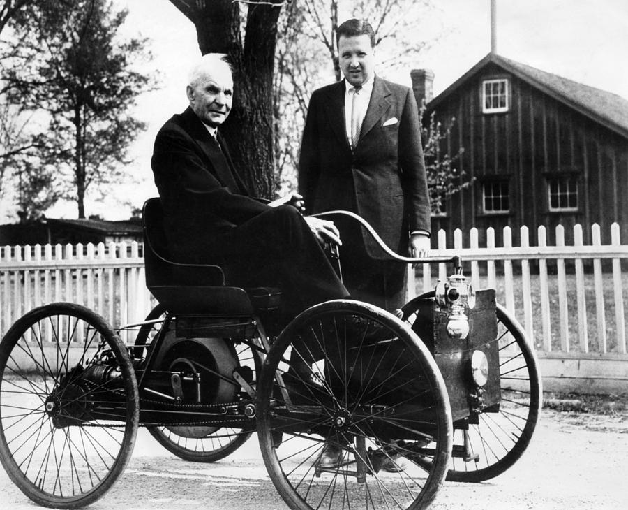 Henry Ford Sits In His First Ford Car Photograph by Everett